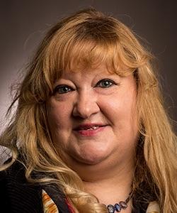cropped studio headshot of Claudia Becker