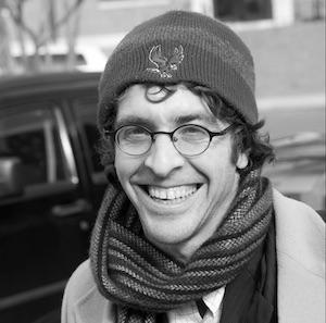 Informal outdoor headshot of Joshua Nadel, wearing NCCU eagle knit cap