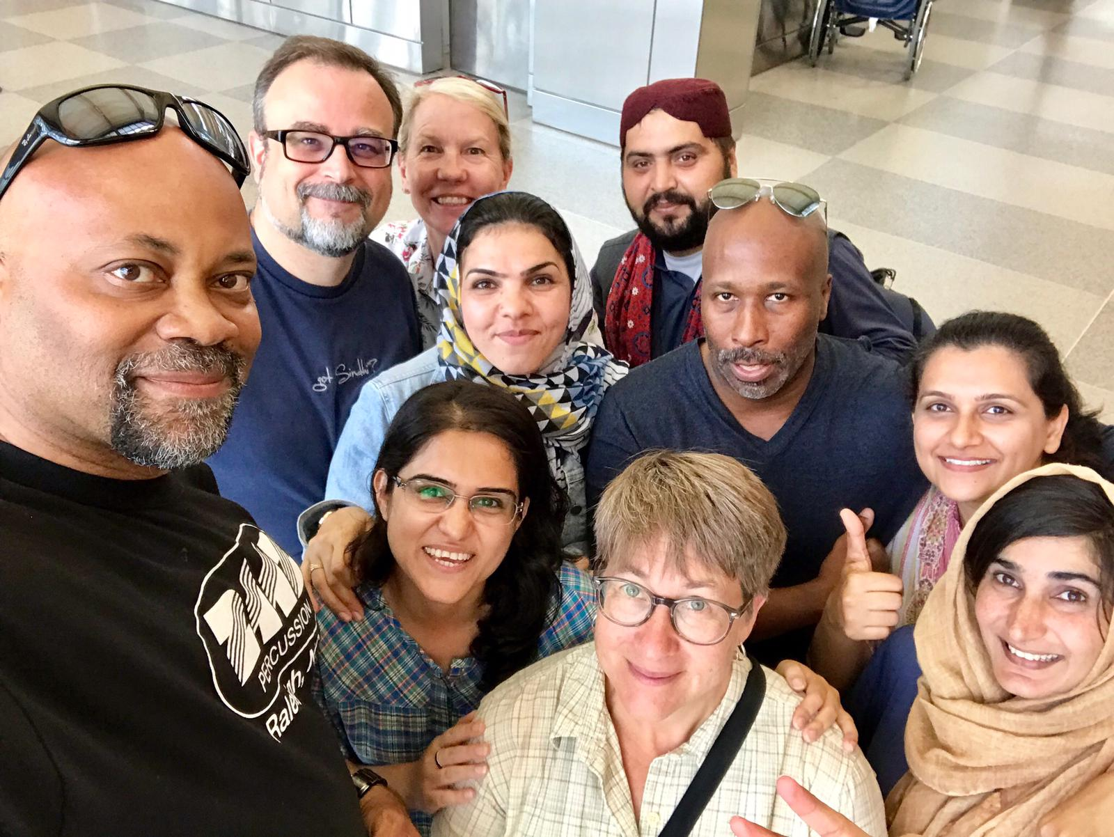 Group selfie of NCCU faculty hosts and Pakistani fellows