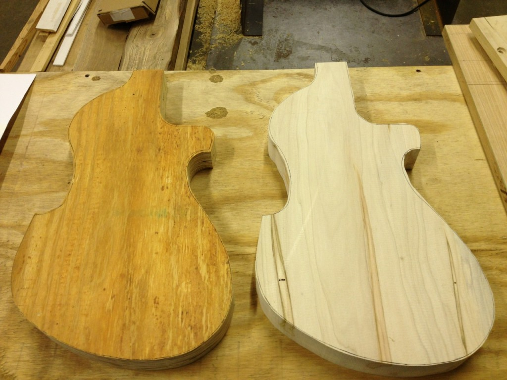 This picture shows two bodies that have been cut out on the bandsaw. The body on the left is made out of construction framing plywood scavenged from a dumpster. The body on the right is made from ambrosia maple.